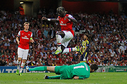 27.08.2013, Emirates Stadion, London, ENG, UEFA CL Qualifikation, FC Arsenal vs Fenerbahce Istanbul, Rueckspiel, im Bild Arsenal's Wojciech Szczesny saves a shot as Arsenal's Bacary Sagna jumps up to avoid a colission during the UEFA Champions League Qualifier second leg match between FC Arsenal and Fenerbahce Istanbul at the Emirates Stadium, United Kingdom on 2013/08/27. EXPA Pictures © 2013, PhotoCredit: EXPA/ Mitchell Gunn<br /> <br /> ***** ATTENTION - OUT OF GBR *****