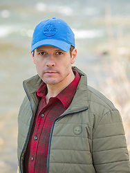 portrait of a man in a cap and winter jacket