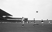 J.J. Cribben (Mayo) Kicks ball watched by Kerry's  Burrowes at the All Ireland Senior Gaelic Football Final in Croke park on the 23rd September 1962. Kerry 1-12 Mayo 1-6. Referee: E. Moules (Wicklow).
