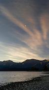 Sunset falls over the mountains of Fiordland National Park and Lake Te Anau; Te Anau, Southland, New Zealand