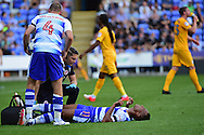 Reading defender Jordan Obita (11) goes down injured during the EFL Sky Bet Championship match between Reading and Preston North End at the Madejski Stadium, Reading, England on 6 August 2016. Photo by Jon Bromley.