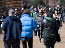 © Licensed to London News Pictures. 04/04/2021. London, UK. Members of the public gather in Hyde Park. On April 12th England is set to relax more lockdown restrictions, which were imposed to control the spread of COVID-19. Photo credit: Ben Cawthra/LNP