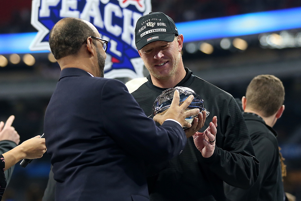 UCF Knights head coach Scott Frost celebrates beating the Auburn Tigers during the 2018 Chick-fil-A Peach Bowl NCAA football game on Monday, January 1, 2018 in Atlanta. The UCF Knights beat the Auburn Tigers 34-27. (Jason Parkhurst / Abell Images for the Chick-fil-A Peach Bowl)