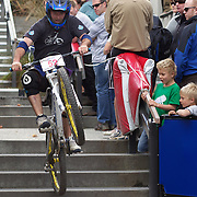 A competitor tackles the Brecon Street steps in Queenstown during the Corona Dirtmasters Downhill event in Queenstown, Central Otago. Eighty competitors tackled the technically demanding course which started at the Gondola summit and finishied with a run down the steps in Brecon Street, Queenstown. The event was part of the inaugural Queenstown Bike Festival, which took place from 16th-25th April. The event hopes to highlight Queenstown's growing profile as one of the three leading biking centres in the world. Queenstown, Central Otago, New Zealand. 24th April 2011. Photo Tim Clayton...