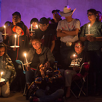 The family of Navajo Nation Police Officer Houston Largo attend a vigil in his honor held at the Gallup Police Department in Gallup Monday March 13.