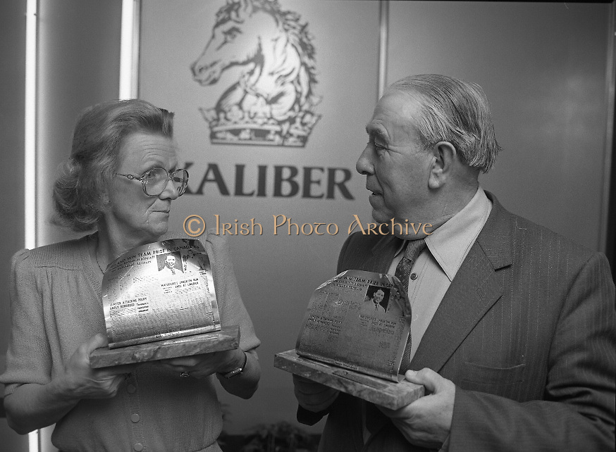 Harry Bradshaw - Christy O'Connor..1986..26.11.1986..11.26.1986..26th November 1986..To commemorate the anniversary of their winning of The Canada Cup in 1956 a presentation was made to Harry Bradshaw and Christy O'Connor. Mr Paul Keogh made the presentation on behalf of,sponsor,Kaliber Lager. The duo won the cup in Mexico City,Mexico..Image of Mrs Mary O'Connor and Mr Harry Bradshaw displaying the awards to commemorate the triumph of Harry and Christy in The Canada Cup of Golf in 1958. They won the cup in Mexico City,Mexico. Mrs O'Connor represented her husband Christy who was unable to attend.