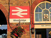 British Rail double arrow logo sign railway train station, Woodbridge, Suffolk, England, UK