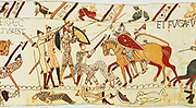 Bayeux Taestry 1067:  Battle of Hastings, 14 October 1066. After death of Harold the Normans, on horseback, mop up the remaining English, on foot in chain mail. English dead in border one, right, being stripped of clothes. Textile Linen