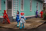 Early morning carnival paraders during Mardi Gras on 25th February 2020 in Marigney district, New Orleans, Louisiana, United States. Mardi Gras is the biggest celebration the city of New Orleans hosts every year. The magnificent, costumed, beaded and feathered party is laced with tradition and  having a good time. Celebrations are concentrated for about two weeks before and culminate on Fat Tuesday the day before Ash Wednesday and Lent.