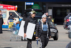 © Licensed to London News Pictures.  12/04/2021. London, UK. Shoppers are seen carrying their shopping from IKEA at Greenwich south London as the government takes the next step on its lockdown-lifting road map and non-essential shops reopen today. Photo credit: Marcin Nowak/LNP