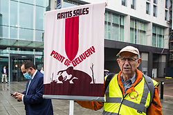 A Quaker holds a banner during a Stop The Arms Fair protest outside ExCeL London on the first day of the DSEI 2021 arms fair on 14th September 2021 in London, United Kingdom. Activists from a range of different groups have been protesting outside the venue for one of the world's largest arms fairs for over a week.