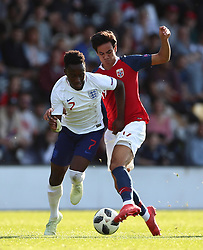 England's Arvin Appiah (left) and Norway's Josef Brian Baccay battle for the ball during the UEFA European U17 Championship quarter final match at the Pirelli Stadium, Burton.