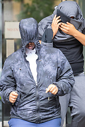 Mohammed Mussa, left, accompanied by a supporter, leaves Highbury Corner Magistrates Court on bail after rising drill music rapper UnknownT - real name Daniel Lena and  Ramani Boreland, were remanded in custody on charges of the murder of Steven Narvaez-Jara, 20, on New Year's Day last year, who together with Mussa who is charged with violent disorder and released on bail.