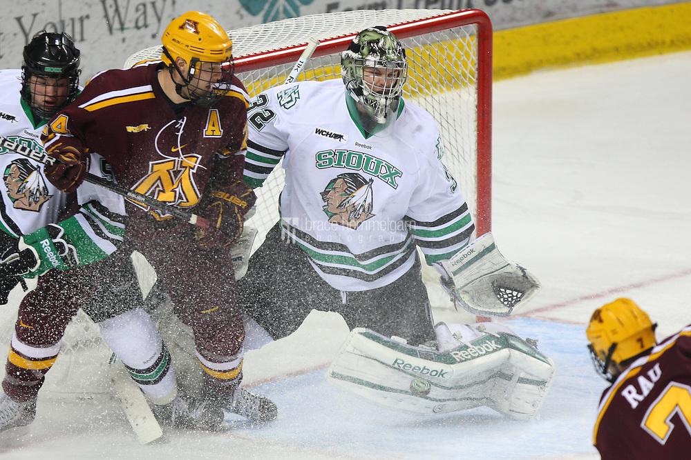 13 January 2012: North Dakota Fighting Sioux goalie Aaron Dell (32) against Minnesota Golden Gophers at Ralph Engelstad Arena in Grand Forks, ND. North Dakota defeated Minnesota 2-1.