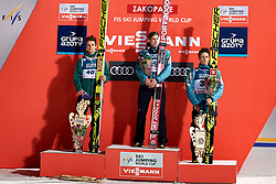 Poland, Zakopane - 2018 January 28: (L-R) Second Andreas Wellinger from Germany and winner Anze Semenic from Slovenia and third place holder Peter Prevc from Slovenia listen national anthem while awarding ceremony 18th World Cup Competition Men's HS140 Large Hill Individual during FIS Ski Jumping World Cup Zakopane 2017/2018 - Day 3 at Wielka Krokiew jumping hill on January 28, 2018 in Zakopane, Poland.<br /> <br /> Mandatory credit:<br /> Photo by © Adam Nurkiewicz<br /> <br /> Adam Nurkiewicz declares that he has no rights to the image of people at the photographs of his authorship.<br /> <br /> Picture also available in RAW (NEF) or TIFF format on special request.<br /> <br /> Any editorial, commercial or promotional use requires written permission from the author of image.