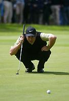 Photograph: Scott Heavey<br />Volvo PGA Championship At Wentworth Club. 25/05/2003.<br />Trevor Immelman lines up a putt.