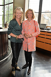 Left to right, KATIE RABETT and JULIA OGILVY at a ladies lunch in aid of the charity Maggie's held at Le Cafe Anglais, 8 Porchester Gardens, London on 29th April 2014.