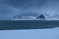Winter view across Nappstraumen towards mountains of Vestvågøy, Lofoten Islands, Norway