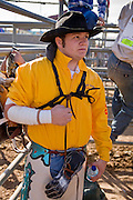 November 2, 2008 -- PHOENIX, AZ: A saddle bronc rider waits to compete at the Arizona High School Rodeo at the Arizona State Fair in Phoenix. Teams from across the state participate. The Arizona High School Rodeo Association sponsors a full season of high school rodeo that culminate in a championship rodeo in June.  Photo by Jack Kurtz / ZUMA Press