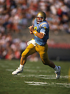 PASADENA, CA-UNDATED:  NFL Hall of Fame and UCLA quarterback Troy Aikman scrambles during a game in the Rose Bowl in Pasadena, California.  Troy Aikman played for the Dallas Cowboys from 1989-2000 and for UCLA from 1986-1989.  (Photo by Ron Vesely)