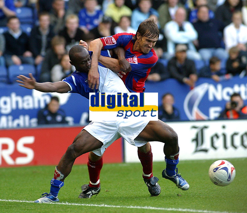 Photo: Dave Linney.<br />Leicester City v Crystal Palace. Coca Cola Championship. 21/10/2006 Leicester City's .Elvis Hammond (L) fends off the challenge from  Matthew Lawrence