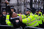 On the day that the UK was scheduled to leave the European Union, a pro leave demonstrator is removed by the police outside Downing Street in London, United Kingdom on 31st October 2019. A further extension has been granted until 31st January 2020 and a general election has been called, in a bid to break the Parliamentary deadlock.