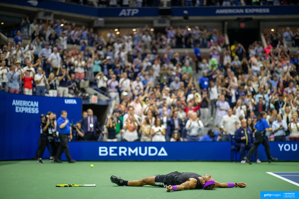 2019 US Open Tennis Tournament- Day Fourteen.   Rafael Nadal of Spain lays on the court to celebrate his five set win against Danill Medvedev of Russia in the Men's Singles Final on Arthur Ashe Stadium during the 2019 US Open Tennis Tournament at the USTA Billie Jean King National Tennis Center on September 8th, 2019 in Flushing, Queens, New York City.  (Photo by Tim Clayton/Corbis via Getty Images)