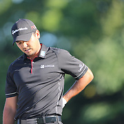 Jason Day, Australia, feels his back after teeing off during The Barclays Golf Tournament at The Plainfield Country Club, Edison, New Jersey, USA. 27th August 2015. Photo Tim Clayton