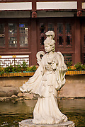 Goddess statue in the lotus pond of the Huxinting Teahouse in Yu Yuan Gardens Shanghai, China