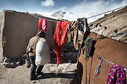 """Getting """"Wuch"""", the fodder for the animals. .The Kyrgyz settlement of Tchelab, near Chaqmaqtin lake, Haji Bootoo Boi's camp...Trekking through the high altitude plateau of the Little Pamir mountains, where the Afghan Kyrgyz community live all year, on the borders of China, Tajikistan and Pakistan."""