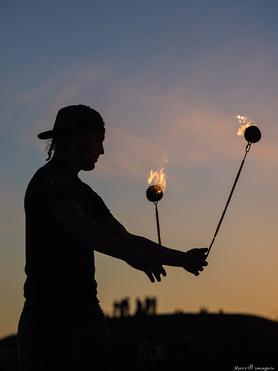 United States, Wasington, Seattle, Gas Works Park,  male fire artist performing.