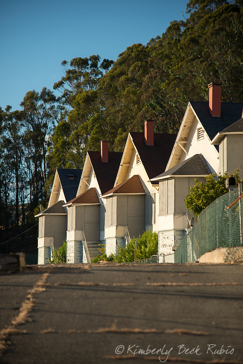 Row of abandoned, boarded up employee homes at Winehaven, a former California winery and Naval fuel depot at Point Molate in Richmond, California.