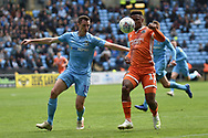 Shrewsbury Town striker (on loan from Stoke City) Tyrese Campbell (11) watches the ball under pressure from Coventry City defender Dominic Hyam (15) during the EFL Sky Bet League 1 match between Coventry City and Shrewsbury Town at the Ricoh Arena, Coventry, England on 28 April 2019.