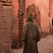 """The red walls of the city, built by Ali ibn Yusuf in 1122ñ1123, and various buildings constructed in red sandstone during this period, have given the city the nickname of the """"Red City"""" or """"Ochre City"""". <br /> <br /> Marrakesh or Marrakech or Me??akec, is a major city of Morocco. It is the fourth largest city in the country, after Casablanca, Rabat and Fes. It is the capital city of the mid-southwestern region of Marrakesh-Asfi. Located to the north of the foothills of the snow-capped Atlas Mountains. Marrakesh is possibly the most important of Morocco's four former imperial cities (cities that were built by Moroccan Berber empires). The region has been inhabited by Berber farmers since Neolithic times, but the actual city was founded in 1062 by Abu Bakr ibn Umar, chieftain and cousin of Almoravid king Yusuf ibn Tashfin. Marrakesh grew rapidly and established itself as a cultural, religious, and trading centre for the Maghreb and sub-Saharan Africa; Jemaa el-Fnaa is the busiest square in Africa.<br /> After a period of decline, the city was surpassed by Fes, but in the early 16th century, Marrakesh again became the capital of the kingdom. Beginning in the 17th century, the city became popular among Sufi pilgrims for Morocco's seven patron saints, who are entombed here.<br /> Tourism is strongly advocated by the reigning Moroccan monarch, Mohammed VI, with the goal of doubling the number of tourists visiting Morocco to 20 million by 2020. Despite the economic recession, real estate and hotel development in Marrakesh has grown dramatically in the 21st century. Marrakesh is particularly popular with the French, and numerous French celebrities own property in the city. Marrakesh has the largest traditional Berber market (souk) in Morocco, with some 18 souks selling wares ranging from traditional Berber carpets to modern consumer electronics. Crafts employ a significant percentage of the population, who primarily sell their products to tourists."""