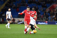 Adam Le Fondre of Cardiff city is tackled by Rotherham's Richard Smallwood. Skybet football league championship match, Cardiff city v Rotherham Utd at the Cardiff city stadium in Cardiff, South Wales on Saturday 6th December 2014<br /> pic by Andrew Orchard, Andrew Orchard sports photography.