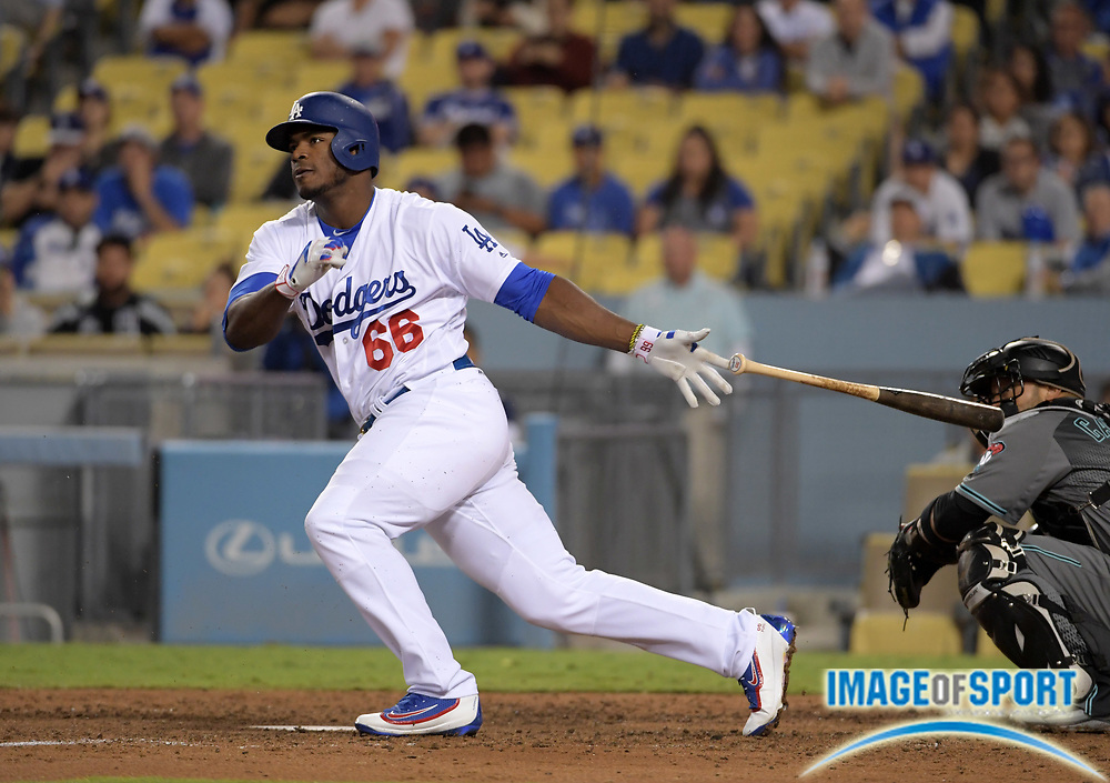 Sep 6, 2016; Los Angeles, CA, USA; Los Angeles Dodgers right fielder Yasiel Puig (66) bats against the Arizona Diamondbacks during a MLB game at Dodger Stadium.