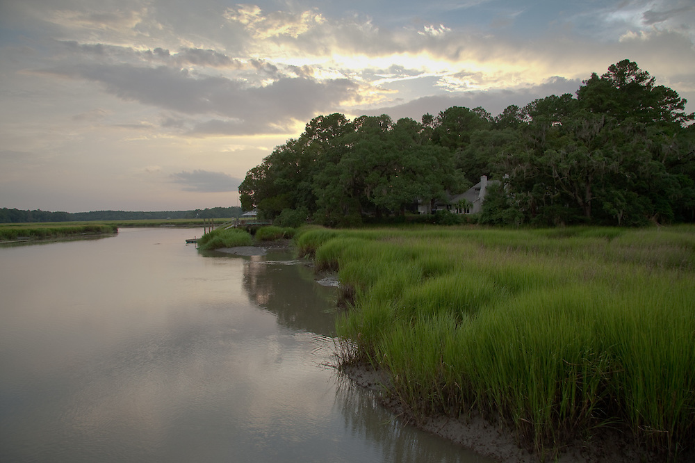 The sunset light glows on the May River marsh, as viewed from the dock at 33 Pine View Drive.