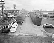 Y-490321-02.  Hawthorne Freight Yards and buildings. Unloading shipment of new cars. March 21, 1949