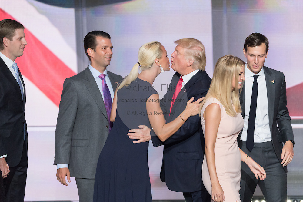 GOP Presidential candidate Donald Trump kisses his daughter-in-law Vanessa Trump as sons Don and Eric look on after accepting the party nomination for president on the final day of the Republican National Convention July 21, 2016 in Cleveland, Ohio.