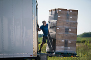 A volunteer unloads a pallet of food items at a pop up grocery event at Prairie Winds Middle School in Mankato, Minnesota, U.S., on Thursday, July 23, 2020. Photographer: Ben Brewer/Bloomberg