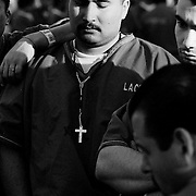 Inmate Paul Zelaya listens with fellow inmates at Pitchess Honor Rancho to a Christian volunteer exorting the virtues of Christianity. Pitchess is part of the sprawling LA County Jail system that houses 21,000 inmates, the world's largest prison population.