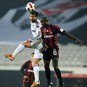 Besiktas's Hugo ALMEIDA (L) and Gaziantepspor's Dany NOUNKEU (R) during their Turkey Cup semi final soccer firsth match Besiktas between Gaziantepspor at the Inonu stadium in Istanbul Turkey on Wednesday 06 April 2011. Photo by TURKPIX