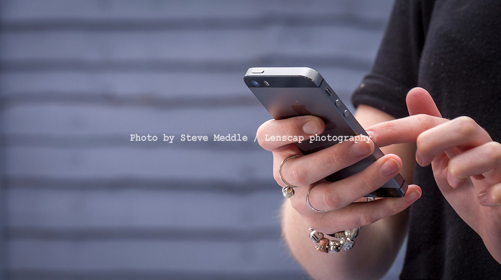 Young Woman using an Iphone - Jun 2014.