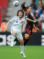 Fotball<br /> VM kvinner 2011 Tyskland<br /> 01.07.2011<br /> Japan v Mexico<br /> Foto: Witters/Digitalsport<br /> NORWAY ONLY<br /> <br /> v.l. Mizuho Sakaguchi, Nayeli Rangel (Mexiko)<br /> Frauenfussball WM 2011 in Deutschland, Japan - Mexiko 4:0
