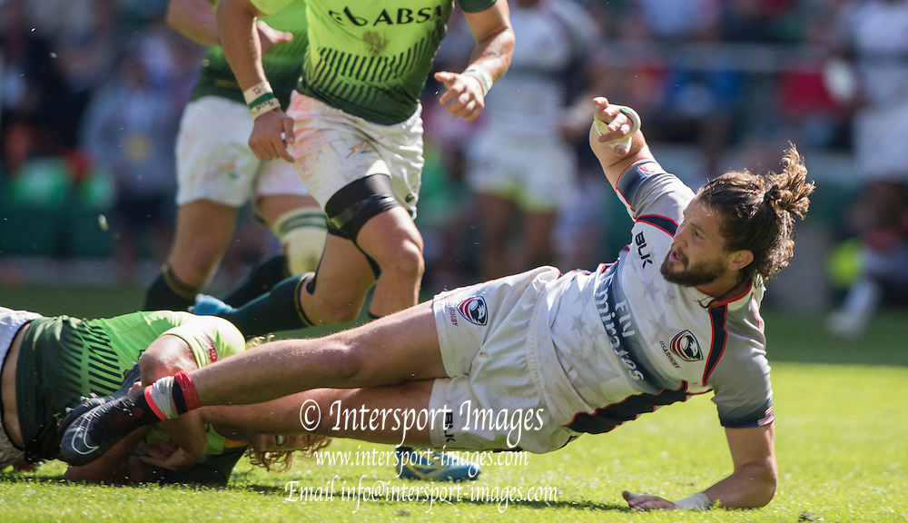 Twickenham, Great Britain,  Danny BARRETT grounded by a low tackle, during the USA vs South Africa [RSA] match at the Marriott London Sevens played at the  RFU Stadium, Twickenham, ENGLAND. Saturday 16.05.2015<br /> [Mandatory Credit; Peter Spurrier/Intersport-images]