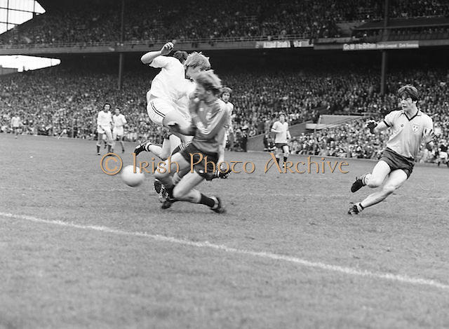 Dublin player comes in high with a tackle on Down as he was about to kick the ball during the Kerry v Dublin All Ireland Senior Gaelic Football Final in Croke Park on the 24th of September 1978. Kerry 5-11 Dublin 0-9.