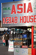 People pass the Asia Kebab House in Southall in West London, also known as 'Little India' by some, is an area almost completely populated by people from South Asia. Figures show that the area is approximately 50 percent Indian in origin although walking the streets it would appear far higher as the local people go about their shopping in the many shops specialising in goods specific to this culture. The mix of religions is mainly Sikh, Hindu and Muslim.<br /> <br /> Southall is primarily a South Asian residential district. 1950 was when the first group of South Asians arrived in Southall, reputedly recruited to work in a local factory owned by a former British Indian Army officer. This South Asian population grew due to the closeness of expanding employment opportunities. The most significant cultural group to settle in Southall are Indian Punjabis.