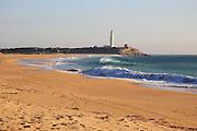 Sandy beach and lighthouse at Cabo de Trafalgar, Cadiz Province, Spain