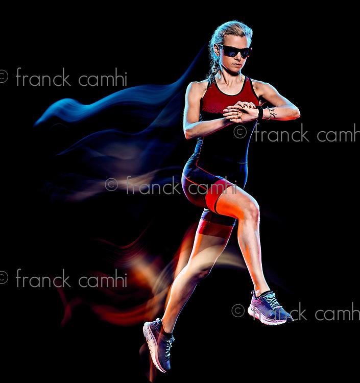 one caucasian woman triathlon triathlete runner running joogger jogging studio shot  isolated on black background with light painting effect