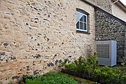 Ground source heat pump, a sustainable source of energy. Llanerchaeron, Wales, UK. Used for heating Llanerchaeron House - a Welsh property of The National Trust. The National Trust have combined efficiency measures and sustainable heating technologies to reduce energy use. As well as cutting down on energy use it has also installed renewable sources of energy, including solar PV and hydro power. Ground source heat pumps, like the one shown here, draw heat from deep in the earth to transform into electricity or keep as heat.